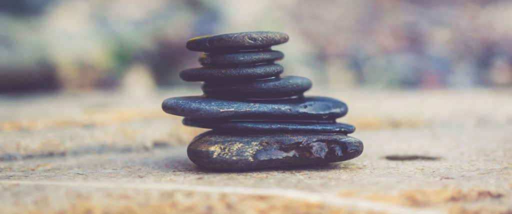 Stacked rocks to symbolize choosing your marketing mix